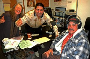 Board President Gale Arnold, DJ Humberto Calderon give a big thank you to Luis F. Serrano for his donation.