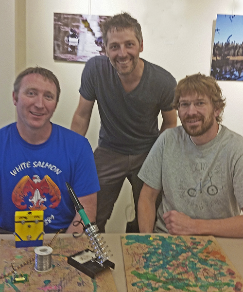Volunteer Ryan Vansickle, (left) Repair Cafe organizer Turner Savard (center) and volunteer Justin Black. Photo: Suzanne Wright